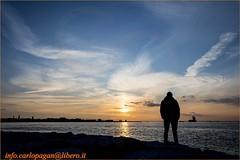 Tramonto in laguna (Carlo Pagan_Photo) Tags: italia italy veneto venezia venice chioggia laguna lagoon tramonto sunset cielo sky mare sea silhouette uomo man allaperto outdoors nuvole clouds acqua water