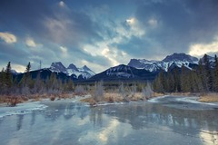Canmore Sky December (John Andersen (JPAndersen images)) Tags: 3sisters alberta canmore clouds fall forest ice kananaskis leaves mountlougheed mountains nakoda reflections waterfall