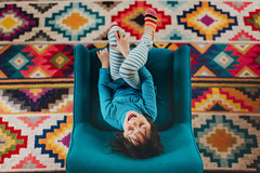 My bright spot (Elizabeth Sallee Bauer) Tags: 5yearold bright chair child childhood children color colorful copyspace family fresh fun girl interior kid laughing life overhead pattern playing rug texture youth
