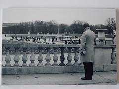 Looking guy (Lauren Clarke Photography) Tags: monochrome blackandwhite tg4 prints filmisnotdead travelphotography paris streetphotography street 50mm18 olympusom10 xp2super400 ilford 35mmfilm