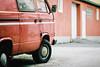 Forming Friendships (Thomas Listl) Tags: thomaslistl color film filmphotography analog minoltax700 kodak portra160 135mm red car bus vw vwbus meinfilmlab muted wall