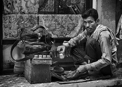 Streetsmart Shoemaker (Rolf Siggaard) Tags: nepal kathmandu ~photography ~angleofview frontview ~orientation landscape ~typeofphotography streetphotography 35mm candid captureone daytime environmental face fujixt2 fujifilm man mirrorless monochrome outdoors people photojournalism portrait street streetlife travelling