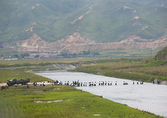 North Korean children crossing a river bare feet, South Hamgyong Province, Hamhung, North Korea (Eric Lafforgue) Tags: challenge children cold colourimage communism connection copyspace countryside crossing danger day dictatorship dprk eti8795 field fulllength greencolor groupofpeople hamhung hill horizontal landscape mountain mountainrange nature northkorea outdoors pioneers plain pupils risk river riverbank socialissues truck walking water southhamgyongprovince 北朝鮮 북한 朝鮮民主主義人民共和国 조선 coreadelnorte coréedunord coréiadonorte coreiadonorte 조선민주주의인민공화국 เกาหลีเหนือ קוריאההצפונית koreapółnocna koreautara kuzeykore nordkorea північнакорея севернакореја севернакорея severníkorea βόρειακορέα