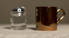 untitled (N.the.Kudzu) Tags: home tabletop macro bottle cup bokeh canon70d zenitar50mmf12 lightroom