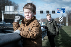 Make 'em honk! (Mark van Oirschot) Tags: boys cute family kids honk truck traffic highway speedway snelweg cars grass focus portrait netherlands a2 guardrail fuji xt2 56mm fujinon tree trafficsign sign