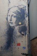 Girl with a pierced eardrum (koukat) Tags: bristol canal water waterside docks banksy girl with pierced eardrum graffiti street art