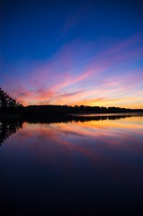Sunset (Stefano Rugolo) Tags: stefanorugolo pentax k5 pentaxk5 smcpentaxda1855mmf3556alwr sunset verticalformat colors blue reflection lake water silhouette sky hälsingland sweden pink orange tree forest