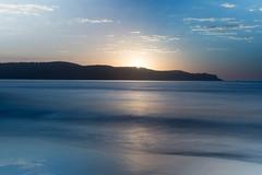 Smooth Sunrise Seascape (Merrillie) Tags: daybreak sunrise headland water newsouthwales sea earlymorning nsw blue smooth ocean sun umina uminabeach morning dawn sky seascape landscape nature australia waterscape