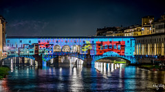 Lights (nicolamariamietta) Tags: florence tuscany arno ponte vecchio river buildings bridge architecture street photography lights colors night sonya7 canon fd 135mm