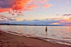 sailor's delight (LilaCheck ) Tags: red sky clouds sunset beach taupo newzealand lake water waves summer people man swimming playing minimal lookingup bright colorful