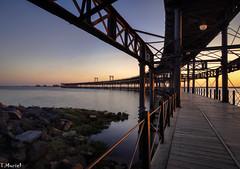 Ocaso en el muelle / Sunset on the dock (tmuriel67) Tags: muelledeltinto huelva tinto ocaso sunset colores colours bridge dock seascape
