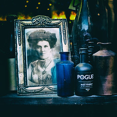 A Pair of Brown Eyes (CarlH55) Tags: pogues whiskey pictureframe blue shelf window bottles oldphotograph irishwhiskey