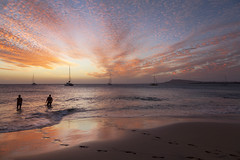The last swim of the day (Jo Evans1) Tags: lanzarote sunset beautiful sky papagayo beach people swimming yachts footsteps sand