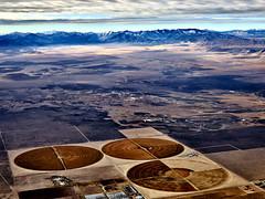 Crops against the terrain of Utah (RickrPhoto) Tags: aerial utah phase one medium format landscape mountains american west sunrise morning crop circle field harvest desert terrain hasselblad