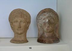 Cremation urn lids (carolyngifford) Tags: birmingham artgallery terracotta heads etruscan