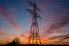 Electrifying sunset (Tony Kanev) Tags: electricity mast