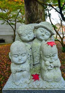Cute statue at autumn park