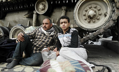 Father and Son face another day sitting and sleeping in front of the tanks surrounding Tahrir Square. (alisdare1) Tags: egypt tahrirsquare tank arabspring cairo fatherandson february2011 uprising revolution breadfreedomsocialjustice freedom mubarak