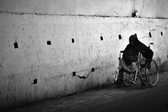 I Ain't Givin' Up Yet ! (N A Y E E M) Tags: woman disabled beggar wheelchair afternoon candid street gmroad chittagong bangladesh windshield