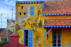 GOREE ISLAND WAS THE PORT WHERE 20,000,000 SLAVES LEFT  AFRICA FOR THE NEW WORLD.   WORLD HERITAGE SITE (UNESCO).  GOREE ISLAND,  SENEGAL, AFRICA (vermillion$baby) Tags: goreeisland slaveprison windowdoor senagal slave senegal africa architecture color structure line building angle old house ocean prison dakar westafrica