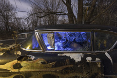 Broken Window Warm-Cool (Notley Hawkins) Tags: httpwwwnotleyhawkinscom notleyhawkinsphotography notley notleyhawkins 10thavenue night nocturne moonlight cadillac brokenwindow carwindow 2018 february missouri boonecountymissouri tree outdoors auto abandoned warmcool bluelight orangelight lightpainting light car windshield