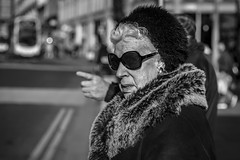 A Golden Age (Leanne Boulton) Tags: portrait urban street candid portraiture streetphotography candidstreetphotography candidportrait streetportrait eyecontact candideyecontact streetlife closeup old elderly woman female lady face expression look emotion mood feeling atmosphere sunglasses faux fur furry coat style stylish fashion tone texture detail depthoffield bokeh naturallight outdoor light shade sunlight shadow city scene human life living humanity society culture people canon canon5d 5dmkiii 70mm character ef2470mmf28liiusm black white blackwhite bw mono blackandwhite monochrome glasgow scotland uk