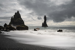 Reynisdrangar - Long Exposure (virtualwayfarer) Tags: iceland is southernregion icelandic nordic island landscape nature naturephotography wild coastal dramatic outdoors powerinnature reynisdrangar longexposure reynisfjara reynisfjarabeach vikimyrdal exposure sea seascape dramaticsky dramaticskies cloudy coastline lowtide basalt volcanic highway1 highwayone alexberger sonyalpha a7rii visiticeland tourismiceland