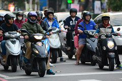 Waiting for Green 3 (Bob Hawley) Tags: asia taiwan kaohsiung nikond7100 nikon80200mmf28af cities streetscenes people traffic vehicles motorbikes motorcycles scooters crosswalks
