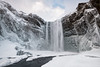 Skogafoss in Winter (B.E.K. Photography) Tags: iceland skogafoss waterfall water sky clouds mountain cliff ice snow icicle longexposure winter river stream white nikond850 nikon1735f28