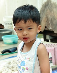 handsome boy with a bib (the foreign photographer - ฝรั่งถ่) Tags: handsome boy bib khlong thanon portraits bangkhen bangkok thailand canon
