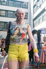 Flea Market Attendee (UrbanphotoZ) Tags: man fleamarket attendee tshirt deco women glasses heartshaped shorts yellow lace bracelets bag attendees schoolbuilding upperwestside manhattan newyorkcity newyork nyc ny
