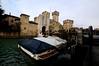 Sirmione 's castle (moniq84) Tags: sirmione lake garda italy italia water boats castle winter landscape