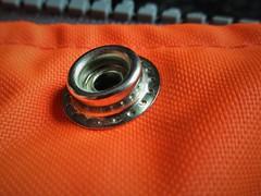 Press Stud (JulieK (thanks for 6 million views)) Tags: hmm macromondays fluorescentjacket fastener 2018onephotoeachday canonixus170 macro orange zip