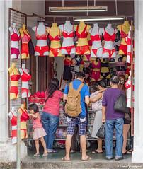 Inquisitive (Fermat48) Tags: georgetown penang malaysia campbellstreet kualakangsarstreet underwear bra pants red inquisitive child rucksack canon eos 7dmarkii