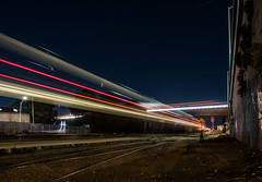 express traveling under grand avenue (pbo31) Tags: bayarea california nikon d810 boury pbo31 january 2018 evening winter lightstream motion night dark black color caltrain express southsanfrancisco station 101 infinity train roadway rail ramp highway overpass gateway grandavenue