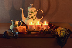 Tea By Candlelight (Lindaw9) Tags: teapot milk pichter candles grapes oranges shadows