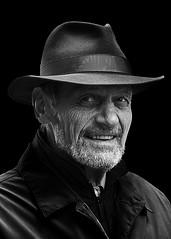 Portrait (D80_497851) (Itzick) Tags: denmark copenhagen candid bw blackbackground bwportrait beard hat man streetphotography smiling d800 itzick