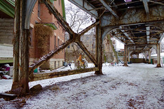 El Horse (KevinIrvineChi) Tags: cta ctabrownline chicago transit train tracks railroad heavy winter snow under rust rusty infrastructure hobby horse plastic toy ride riding ravenswood overcast outdoors house brick porch chandelier sony dscrx100 curbedchicago boingboing grass brown white railing braces x brace trees lawn