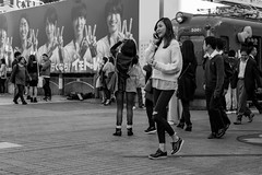 Rearranging Her Schedule (burnt dirt) Tags: asian japan tokyo shibuya station streetphotography documentary candid portrait fujifilm xt1 bw blackandwhite laugh smile cute sexy latina young girl woman japanese korean thai dress skirt shorts jeans jacket leather pants boots heels stilettos bra stockings tights yogapants leggings couple lovers friends longhair shorthair ponytail cellphone glasses sunglasses blonde brunette redhead tattoo model train bus busstation metro city town downtown sidewalk pretty beautiful selfie fashion pregnant sweater people person costume cosplay ripped torn knee