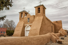 San Francisco de Asis Church (KPortin) Tags: church sanfranciscodeasischurch newmexico crosses belltowers wall doors nationalregisterofhistoricplaces architecture clouds