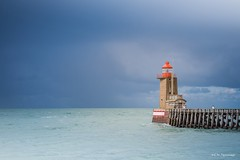 Moments before the storm.... (crispin52) Tags: france normandy fécamp lighthouse storm rain clouds water sea nikon waves