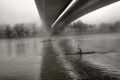 Titans in the fog. (Fencejo) Tags: canon600dt3ikissx5 tamronspaf2875mmf28xrdild streetphotography ebro fog zaragoza canoe snapseed river