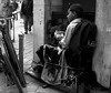 From the sidelines (magiceye) Tags: boy sitting pavement streetportrait streetphoto mumbai india monochrome blackandwhite bnw