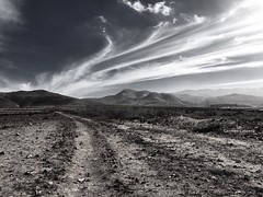 Country road (Carmen Cabrera .) Tags: blackandwhite clouds cloudscape hill mountainrange landscape mountain mountainspeak horizonoverland ridge scenery rollinglandscape countryroad bw blancoynegro iphoneography iphoneographer iphoneart horizon walking afternoon outdoor freedom adventure lonely lonelyness infinitexposure