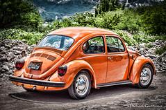 Orange VW Bug (explored) (Michael Guttman) Tags: sliderssunday vw bug vwbug volkswagen sanmigueldeallende mexico orange overprocessed car automobile classicautomobile vwbeetle beetle