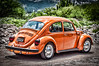 Orange VW Bug (explored) (Michael Guttman) Tags: sliderssunday vw bug vwbug volkswagen sanmigueldeallende mexico orange overprocessed car automobile classicautomobile vwbeetle beetle