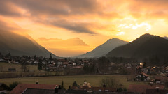 Zugspitze at Sunset (redfurwolf) Tags: sunset zugspitze mountains village eschenlohe bavaria germany sky clouds orange field houses landscape outdoor nature ngc redfurwolf sony rx100m4