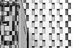 three lamps behind the windows (christikren) Tags: austria architecture blackwhite christikren facade geometry sw vienna windows lamp panasonic lines