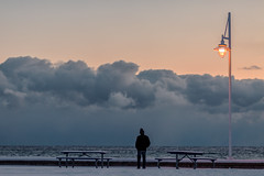 solitude (Marc McDermott) Tags: winter sunset clouds person solitude lakeontario ontario canada sky snow cold street lamp picnic table