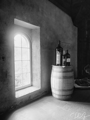 Wine with a View (Dcgreen5) Tags: naturallight olympus california napa charleskrug light window blackandwhite barrel wine